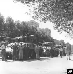 Iranian army troops and tanks stand in front of Central Police headquarters after the attempted coup d'etat against Iranian Premier Mohammad Mossadeq in Tehran, Iran, Aug. 16, 1953.
