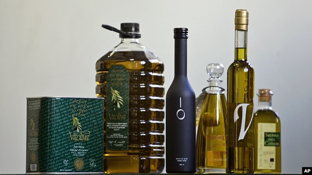 Extra virgin olive oil bottles are displayed in a specialized shop in the center of Madrid, July 29, 2005.