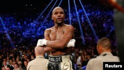 Floyd Mayweather, Jr. of the U.S. stands up on the ropes in his corner after defeating Manny Pacquiao of the Philippines in their welterweight WBO, WBC and WBA (Super) title fight in Las Vegas, Nevada, May 2, 2015.