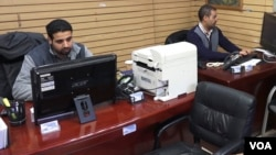 Travel agent Waddah Mubarez (right) says bookings among Yemenis have been down by more than 50% over the past year. But his biggest concern is being separated from his mother, who cannot travel to the United States due to travel restrictions placed on Yem