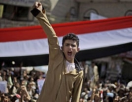 An anti-government protester shouts slogans along with other demonstrators during a demonstration demanding the resignation of Yemeni President Ali Abdullah Saleh, in Sanaa, February 26, 2011