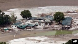 A June 23, 2013 photo shows damaged houses by the River Ganges in Guptkashi, India.