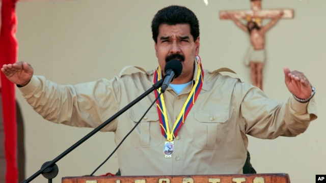 In this photo released by Miraflores Press Office, Venezuela's Nicolas Maduro speaks to soldiers inside a military base in Coro, Venezuela, Sept. 30, 2013.