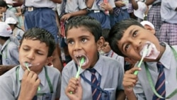 Children in New Delhi in a 2007 attempt to break a world record for the most people brushing their teeth together in multiple venues