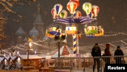 FILE - People gather near a New Year fair in Red Square, Moscow, Russia.