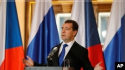 Russia's President Dmitry Medvedev attends a news conference at Prague Castle, December 8, 2011.