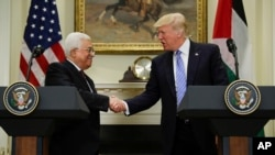FILE - President Donald Trump shakes hands with Palestinian leader Mahmoud Abbas after their statements in the Roosevelt Room of the White House in Washington, May 3, 2017.