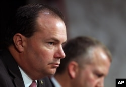 Sen. Mike Lee, R-Utah, listens during a Senate Armed Services Committee on Capitol Hill in Washington, July 21, 2015.