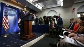 President Barack Obama speaks in the White House Briefing Room in President Barack Obama speaks preparations for Hurricane Sandy, in the White House Briefing Room in Washington, October 29, 2012.