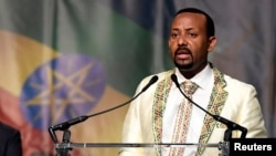 FILE - Ethiopia's prime minister, Abiy Ahmed, addresses his country's diaspora in Washington, the largest Ethiopian community outside the country, calling on them to return, invest and support their native land, on July 28, 2018.