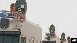 Saudi Arabian troops cross the causeway leading to Bahrain in this still image taken from video, March 14, 2011
