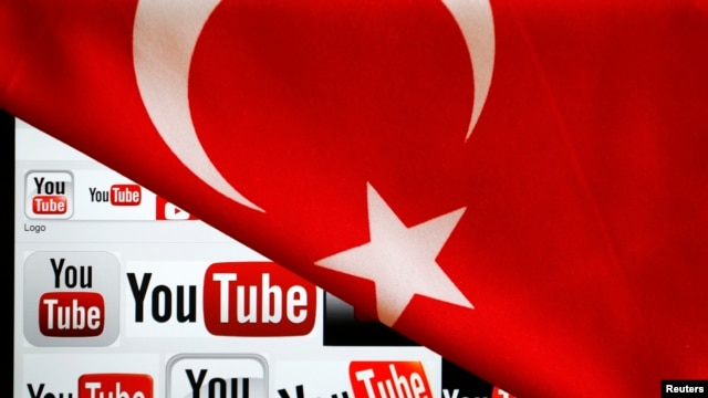YouTube logos displayed on a laptop screen partially covered with Turkey's national flag in this photo illustration taken in Ankara, March 27, 2014.