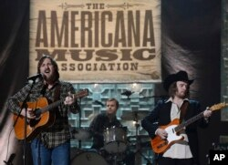 Sturgill Simpson, left, performs during the Americana Music Honors and Awards show, Sept. 17, 2014, in Nashville, Tennessee.
