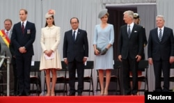 Britain's Prince William, his wife Catherine, French President Hollande, Queen Mathilde of Belgium, King Philippe of Belgium and German President Joachim Gauck attend a ceremony commemorating the 100th anniversary of the outbreak of WWI in Liege, Aug. 4, 2014.