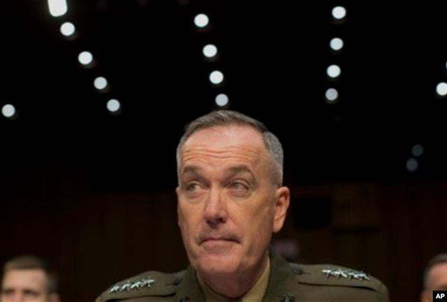 FILE - General Joseph Dunford testifies on Capitol Hill, March 12, 2014.