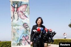Taiwanese President Tsai Ing-Wen standing by a section of the Berlin Wall speaks to media at the Ronald Reagan Presidential Library in Simi Valley, California, Aug.13, 2018.
