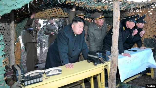 North Korean leader Kim Jong-Un (C) watches soldiers of the Korean People's Army (KPA) taking part in drills on March 25, 2013, in this picture released by the North's KCNA news agency.