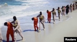 FILE - Islamic State militants force Ethiopian Christians along a beach in Libya in this undated image found on social media in April 2015.