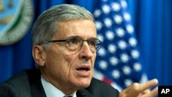 FILE - FCC Chairman Tom Wheeler, writing in Wired magazine, says he wants to protect the rights of Internet users through government regulation.