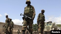 African Union (AU) soldiers patrol in front of their military base in the lower Shabelle region, outside Somalia's capital Mogadishu, July 3, 2012.