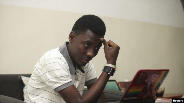 Rashidi Williams, a gay man, works on his laptop in Lagos, Nigeria, in this Nov. 17, 2011 photo.
