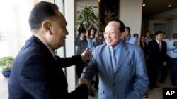 Foreign Ministers, Hor Namhong, right, of Cambodia, and Kasit Piromya, left, of Thailand, shake hands before a meeting in the Foreign Ministry in Phnom Penh, Cambodia, Thursday, Dec. 30, 2010.