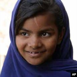This photograph shows a young Pakistani girl, Javaria, who is now attending school.