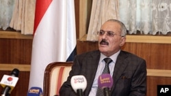 Outgoing Yemeni President Ali Abdullah Saleh speaks to the press at the presidential palace in Sana'a, January 22, 2012.