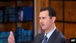 Tổng thống Syria Bashar al-Assad trong một cuộc phỏng vấn trên truyền hình ngày 25/9/2013.