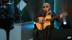FILE - Musician Jose Feliciano performs during the Library of Congress Gershwin Prize ceremony on March 13, 2019, in Washington, D.C. Feliciano is celebrating 50 years of his beloved Spanish/English Christmas song 'Feliz Navidad' by releasing a new versio
