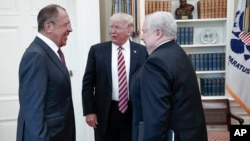 U.S. President Donald Trump meets with Russian Foreign Minister Sergey Lavrov, left, next to Russian Ambassador to the U.S. Sergei Kislyak at the White House in Washington, May 10, 2017.
