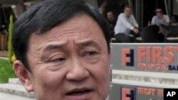 泰國反對黨就逃亡中的泰國前總理他信獲發日本簽証﹐要求政府解釋在有關決定中扮演的角色。