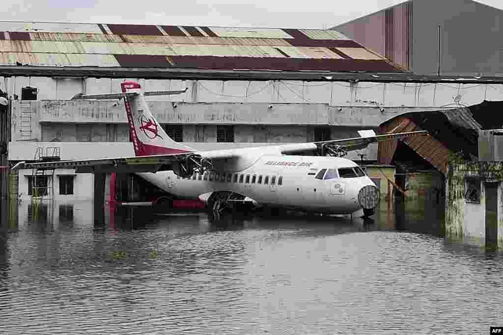 An aircraft is parked at the flooded Netaji Subhas Chandra Bose International Airport after the landfall of cyclone Amphan in Kolkata, India.