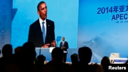 President Barack Obama speaks at the at the APEC CEO Summit in Beijing, November 10, 2014.