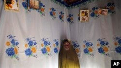 FILE - Child bride Sarey Amadou, 14, in her bedroom in Hawkantaki, Niger.