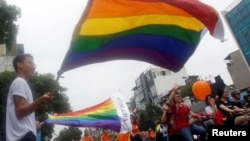 FILE - Participants attend the 5th annual LGBT pride parade in Hanoi, Vietnam, Aug. 21, 2016. East Timor, Asia's youngest nation, held its second LGBT pride parade July 21.