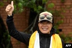 Pendaki gunung Kong Tsang Yin-hung, yang mencatat pendakian Gunung Everest tercepat di dunia (8.848,86 meter) oleh seorang wanita dalam 25 jam 50 menit, Kathmandu pada 30 Mei 2021. (Foto: AFP)