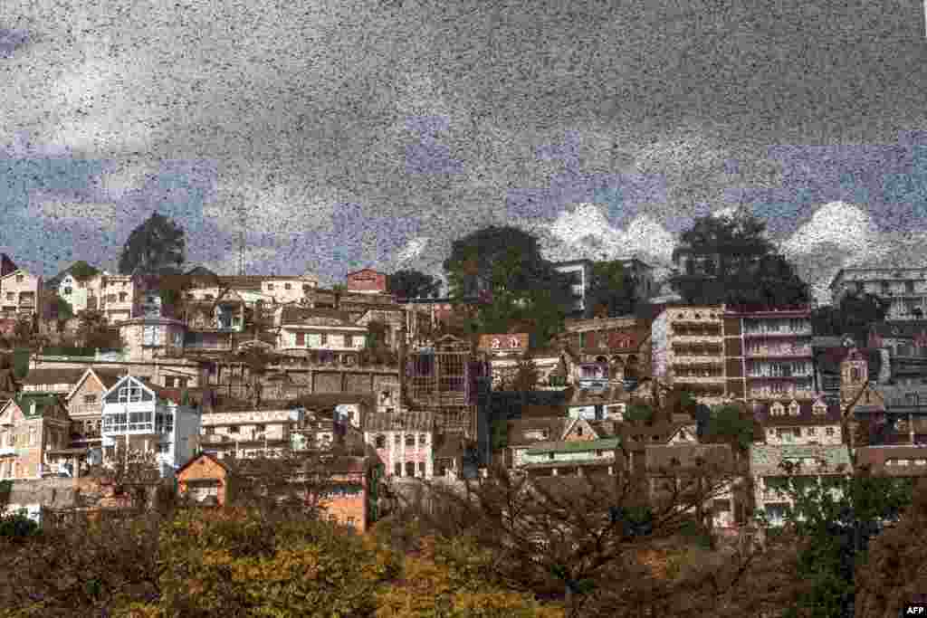 A swarm of locusts invades the center of Madagascar capital Antananarivo.