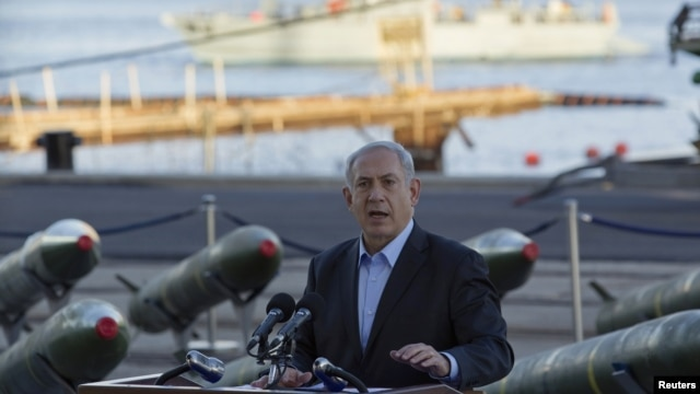Israel's Prime Minister Benjamin Netanyahu speaks to the media in front of a display of M302 rockets, found aboard the Klos C ship, at a navy base in the Red Sea resort city of Eilat on March 10, 2014.