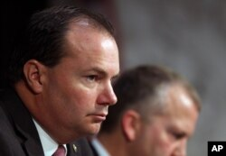FILE - Sen. Mike Lee, R-Utah, listens during a Senate Armed Services Committee on Capitol Hill in Washington, July 21, 2015.
