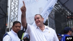 Guatemalan candidate for the Vamos party Alejandro Giammattei gestures to supporters at a campaign rally in Guatemala City, Aug. 4, 2019. Giammattei will face National Union of Hope candidate Sandra Torres.
