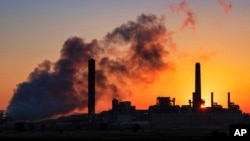 FILE - Dave Johnson coal-fired power plant near Glenrock, Wyoming. CO2 emissions from the world's electric power industry fell two percent in 2019.