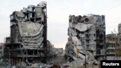 Destroyed buildings are seen on a deserted street in Homs, Syria January 30, 2013. At least 60,000 people have been killed in Syria's civil war.
