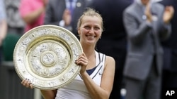 Petra Kvitova of the Czech Republic holds her trophy after defeating Russia's Maria Sharapova in the ladies' singles final at the All England Lawn Tennis Championships at Wimbledon, July 2, 2011.
