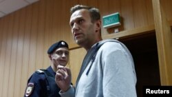 Russian opposition leader Alexei Navalny, who was recently detained over his participation in an anti-government protest in Jan. 2018, attends a court hearing in Moscow, Aug. 27, 2018.