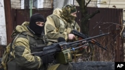 FILE - Russia-backed rebels take positions on the outskirts of Donetsk, eastern Ukraine, April 2, 2015.