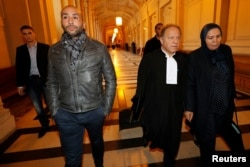 Latifa Ibn Ziaten (R), mother of a French soldier slain by Islamist Mohammed Merah in 2012, arrives at the trial of Abdelkader Merah, brother of the gunman, Paris, France, Oct. 2, 2017.
