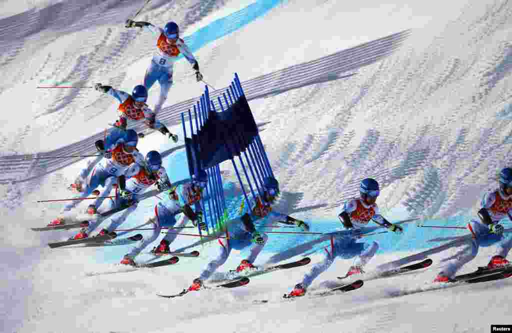 This multiple exposure image shows Austria's Benjamin Raich clearing a gate during the second run of the men's alpine skiing giant slalom event at the 2014 Sochi Winter Olympics, Rosa Khutor Alpine Center, Feb. 19, 2014.