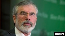 Sinn Fein's Gerry Adams holds a news conference following his release from police detention, in Belfast, May 4, 2014.