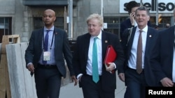 Britain's Foreign Secretary Boris Johnson arrives for a reception at the Royal Ontario Museum on the first day of meetings of foreign ministers from G-7 countries in Toronto, Canada, April 22, 2018.